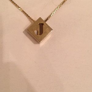 Gold colored J initial necklace